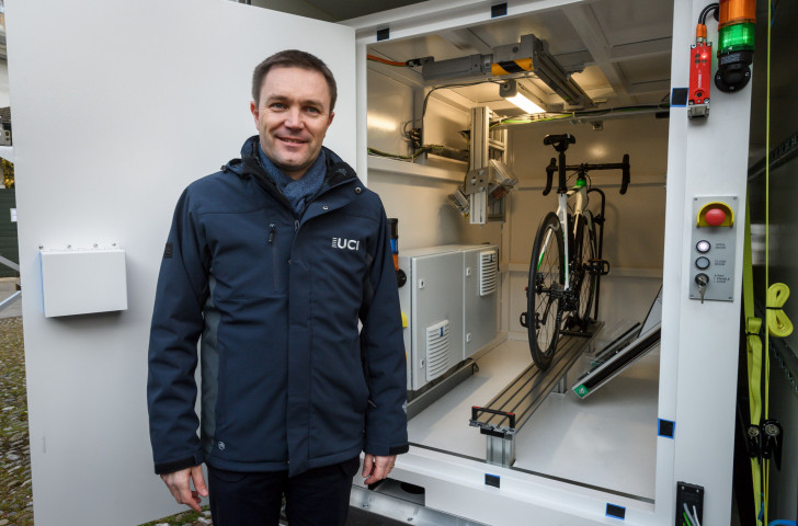 UCI President David Lappartient pictured in March in front of one of the new x-ray machines designed to detect technological cheating within bike frames ©Getty Images