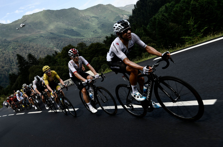 Team Sky's Jonathan Castroviejo of Spain, followed by Poland's Michal Kwiatkowski, lead out during the 19th stage of this year's Tour de France for their team-mate in the overall leader's yellow jersey, eventual winner Geraint Thomas ©Getty Images