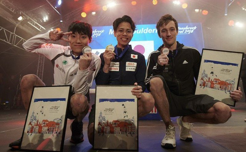 Kai Harada, centre, will feature in tomorrow's combined finals ©IFSC