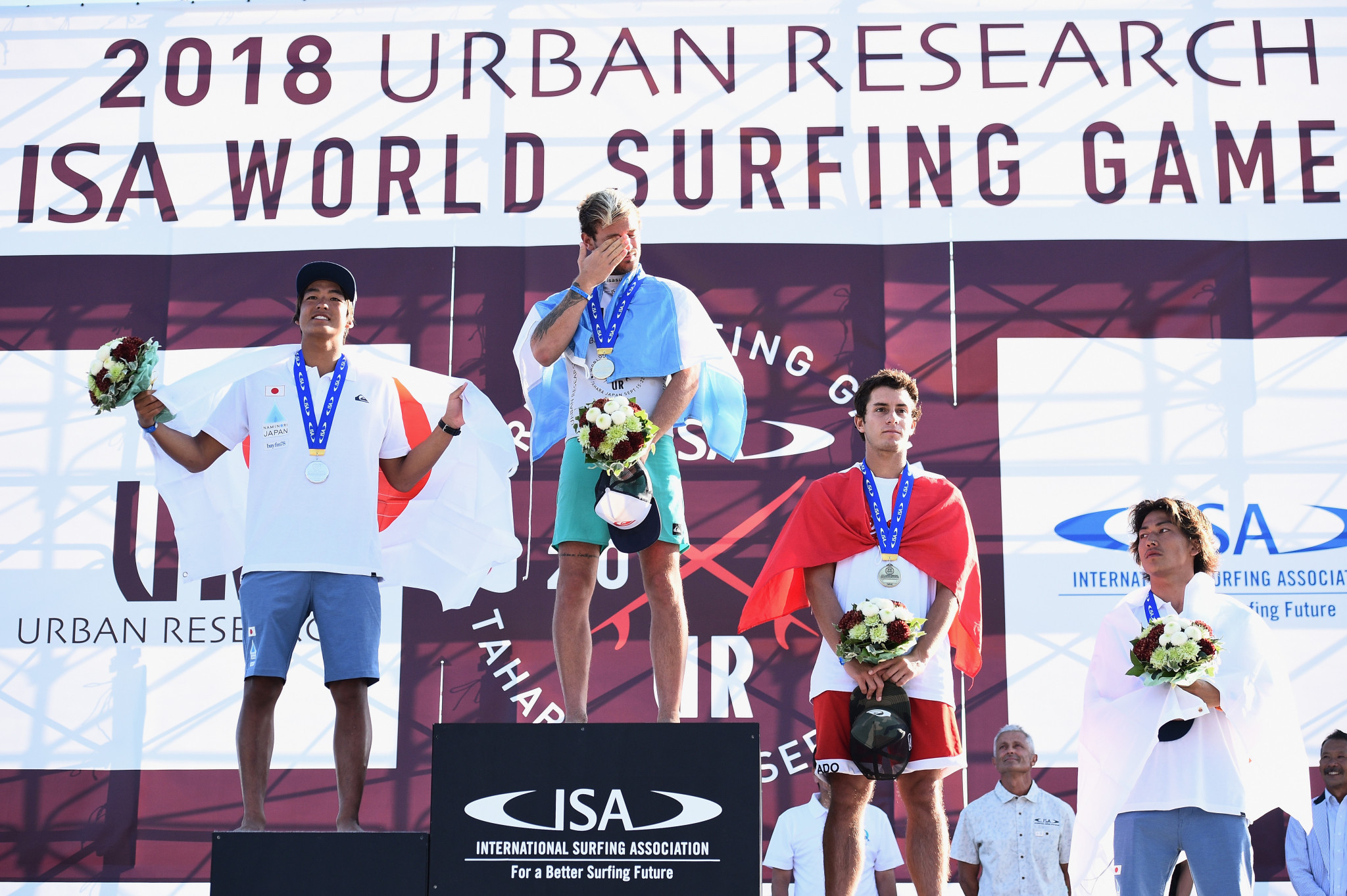 Santiago Muñiz of Argentina, Kanoa Igarashi, of Japan, Lucca Mesinas of Peru and Shun Murakami of Japan on the podium after earning medals at the ISA World Surfing Games in Tahara in Japan ©Getty Images