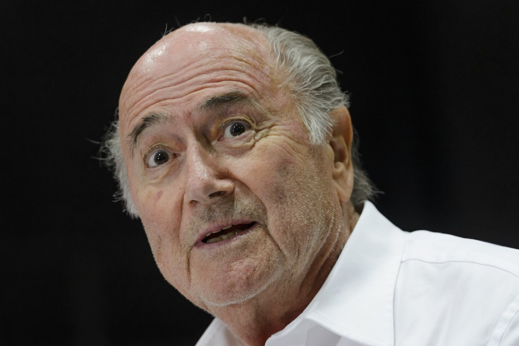 "FIFA President Blatter won't step down early as UEFA chief Platini breaks silence on ""disloyal"" payment"