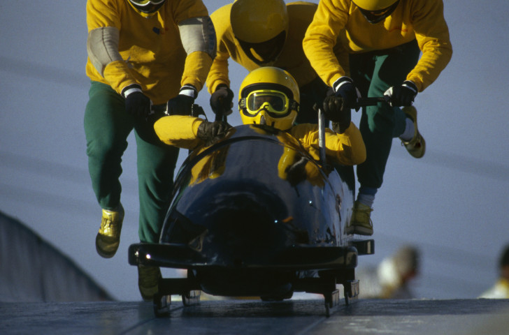 Dudley Stokes Jr in command of the Jamaican four man bobsleigh team at the 1988 Winter Olympic Games in Calgary which inspired the hit Hollywood movie Cool Runnings ©Getty Images