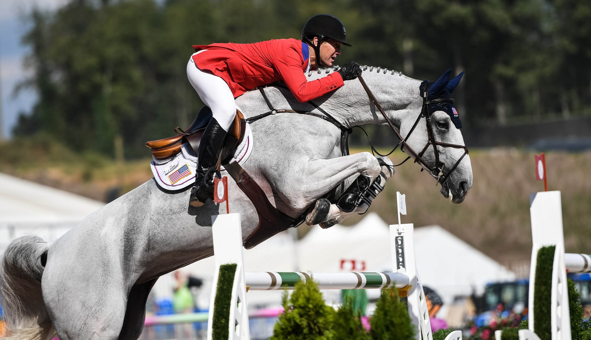 US hosts move up to challenge Switzerland in team jumping at FEI World Equestrian Games