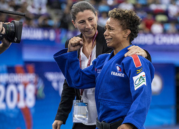 France's world number one Amandine Buchard leaves the mat in tears after securing the World Championships bronze medal ©IJF