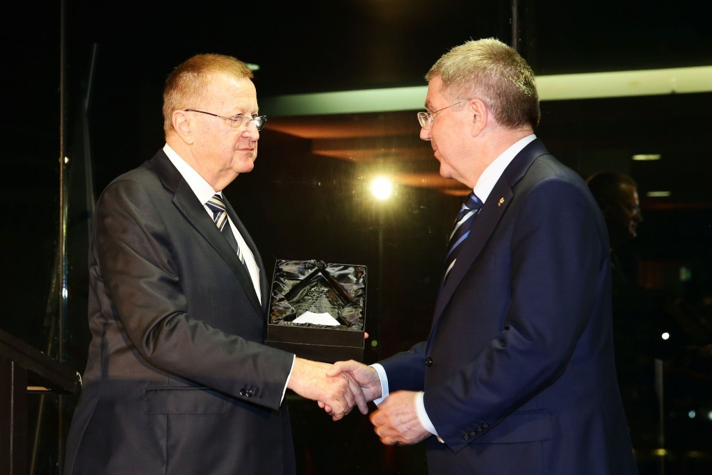 Thomas Bach receiving the IOC Order of Merit Award from AOC counterpart, and IOC vice-president, John Coates