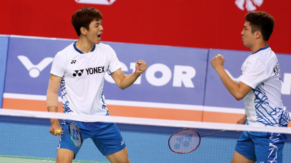 Lee Yong Dae and Kim Gi Jung celebrate winning in the first round of the Korea Open in Seoul ©BWF
