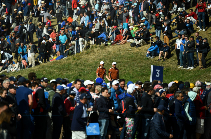 Europe's Tommy Fleetwood, left, and Francesco Molinari, who finished the day having won their fourth out of four matches, make their way on the course at Paris today ©Getty Images