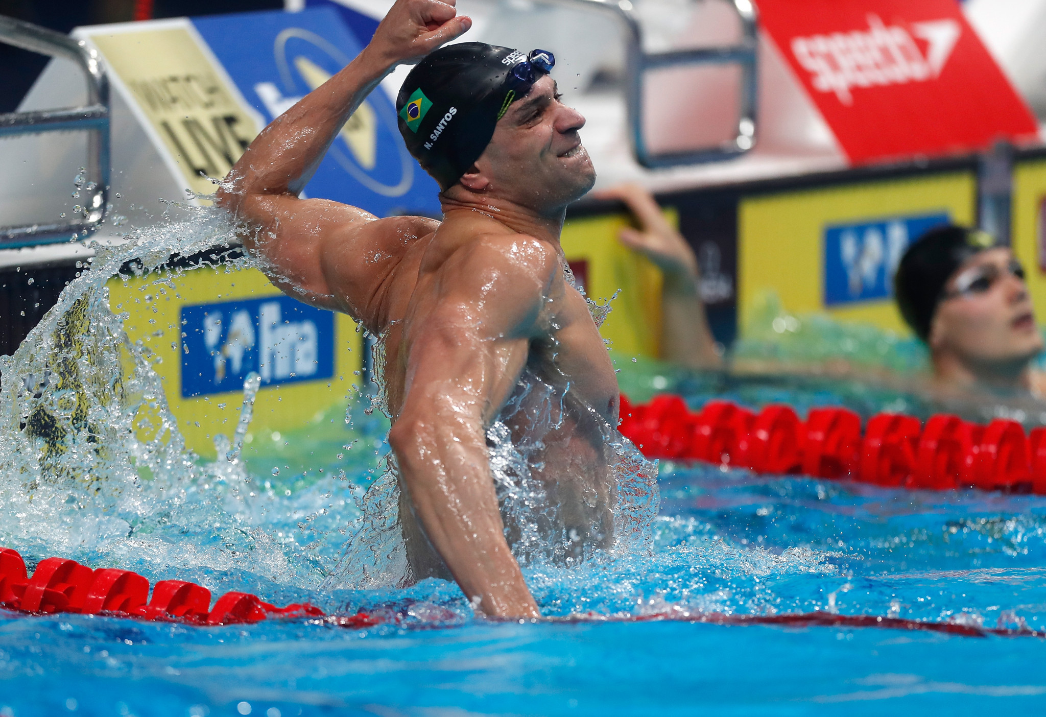 Brazil's Nicholas Santos celebrates breaking the  world record for the 50m men's fly race at the Fina Swimming World Cup in Budapest ©FINA