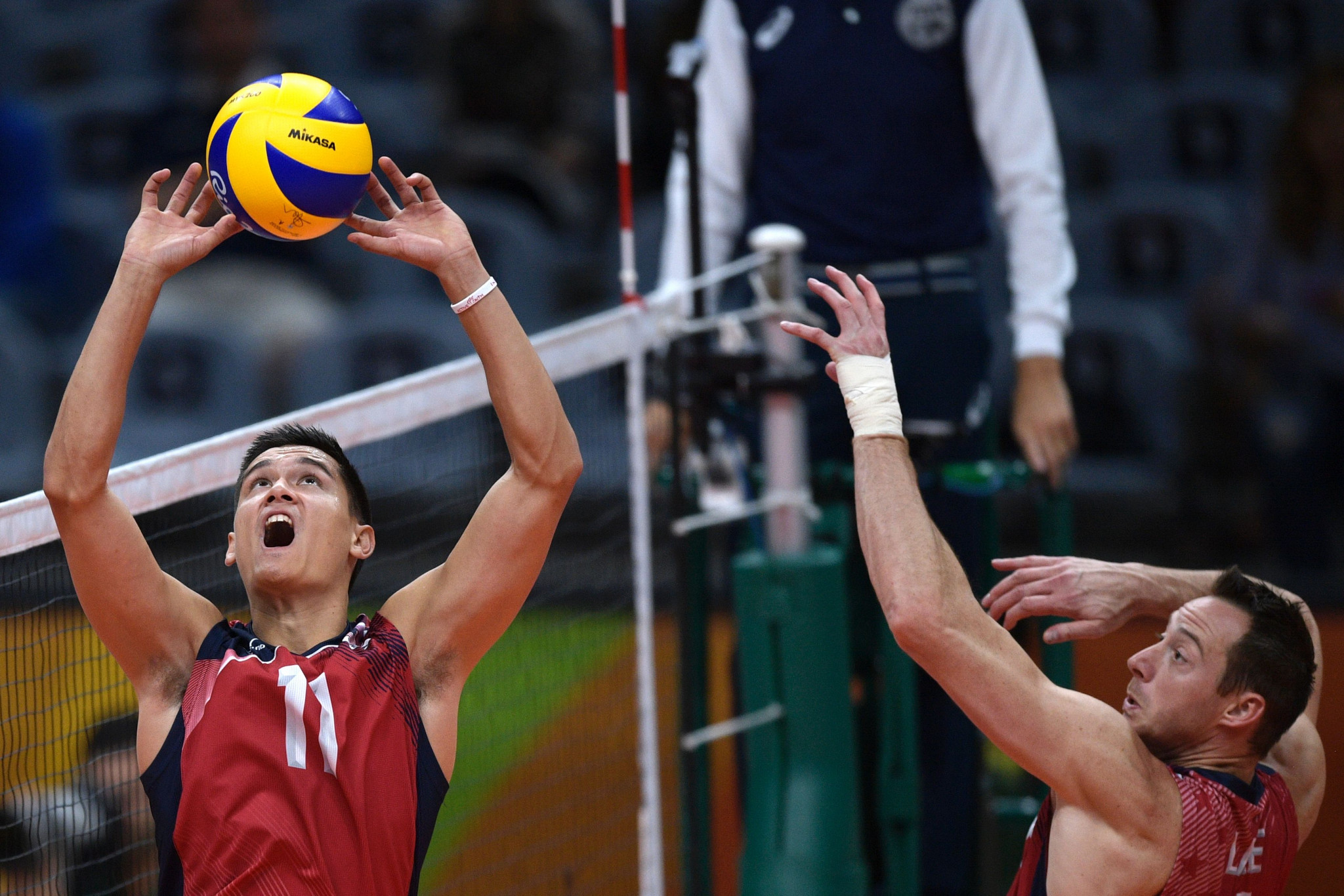 Volleyball Olympic champion David Lee, right, will make his beach debut in the qualification round ©Getty Images