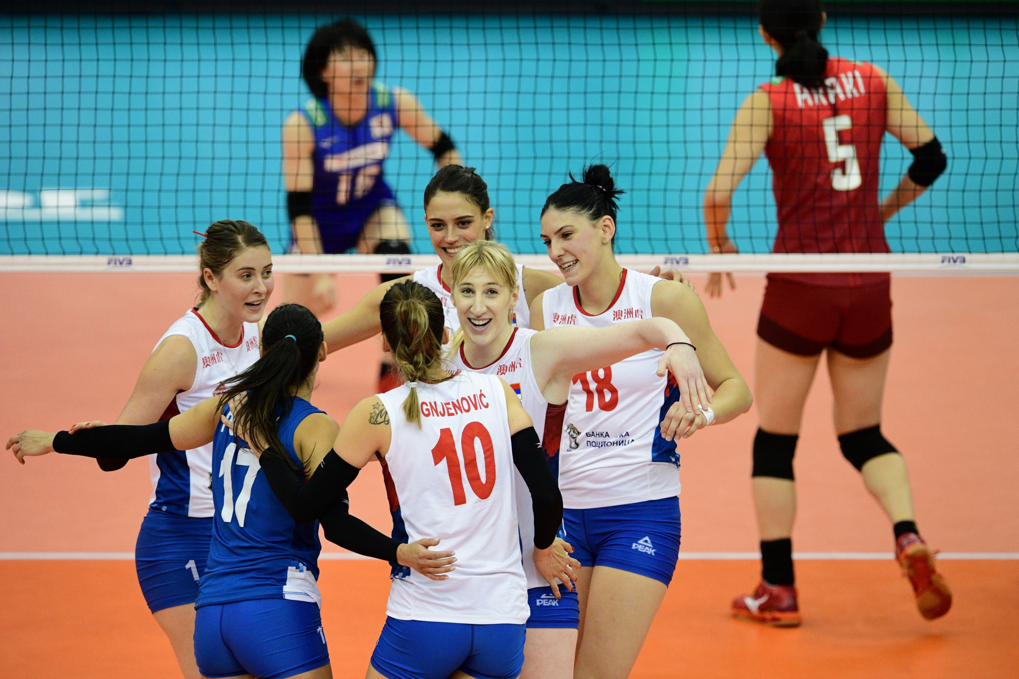 Serbia celebrate winning a point against Japan in the third round of the FIVB Women's World Volleyball Championships in Japan, a match which they eventually won ©Getty Images