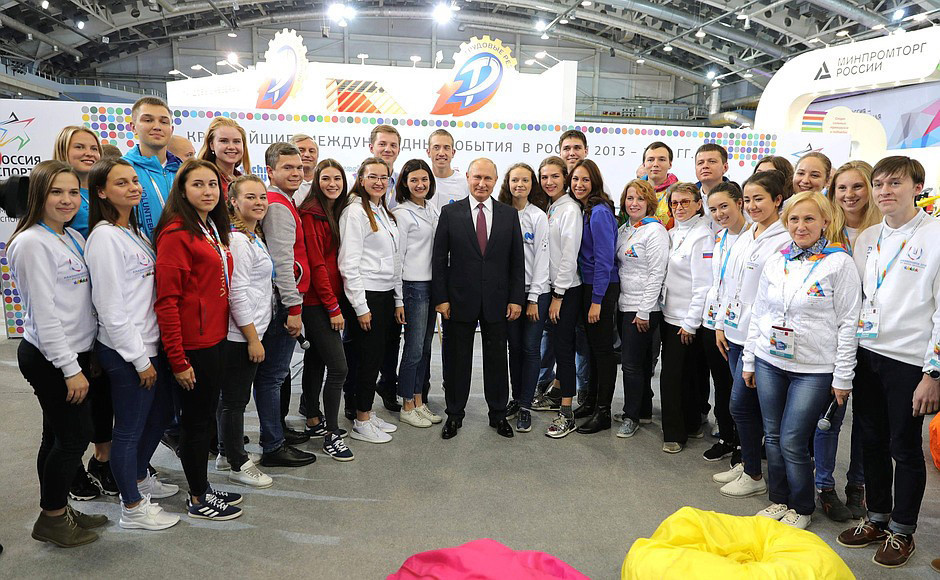 Vladimir Putin talks with the volunteers who will help run the Krasnoyarsk 2019 Winter Universiade ©FISU