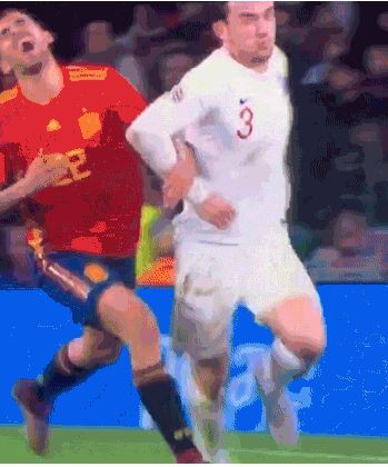 Spain's Dani Ceballos suffers a mysterious pain after not connecting with the elbow of England's Ben Chilwell in Seville on Monday night - leading to plenty of criticism on social media ©Twitter