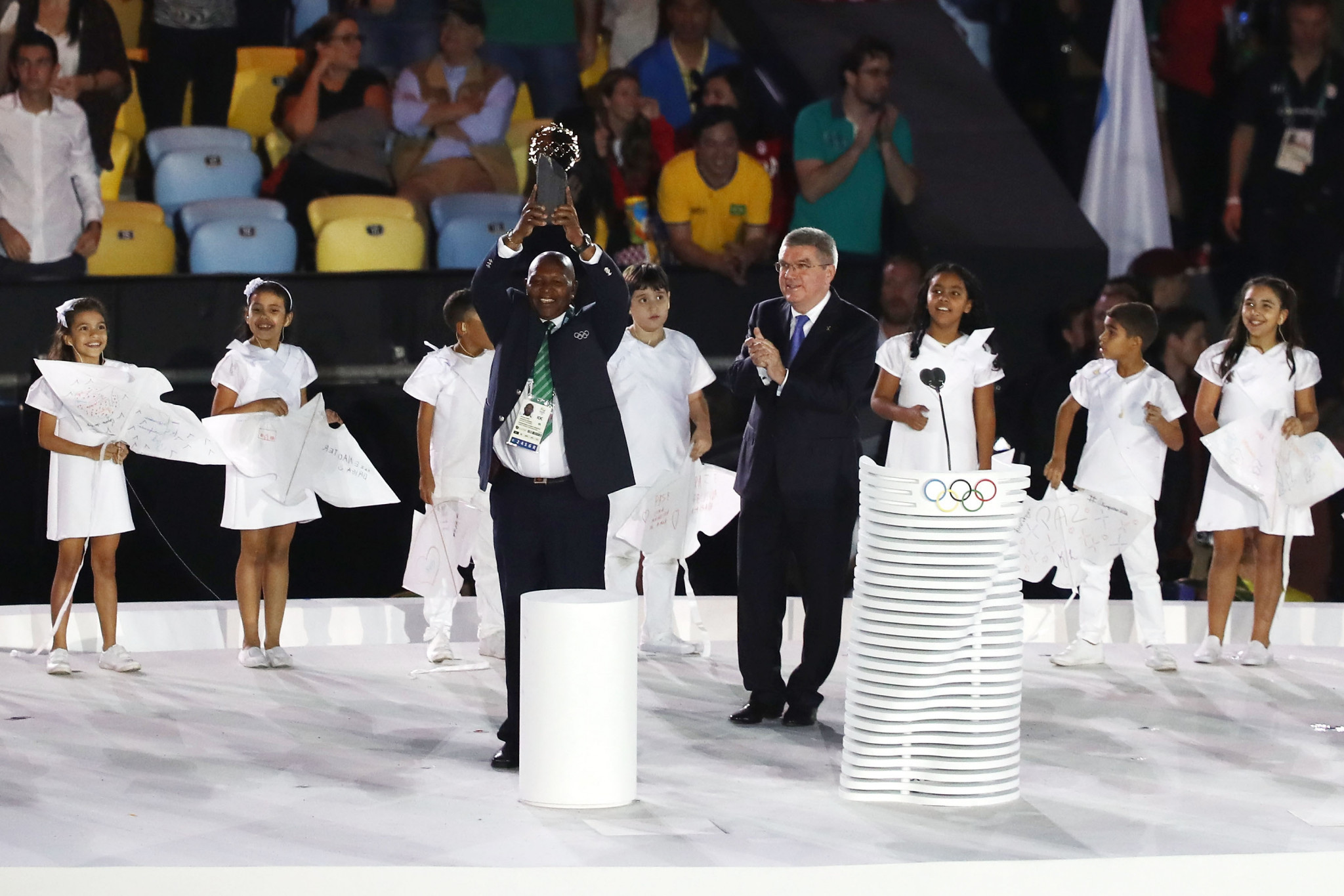 Kenya's double Olympic gold medallist Kip Keino received the first-ever Laurel Award during the Opening Ceremony of Rio 2016 from IOC President Thomas Bach but is now facing criminal charges ©Getty Images