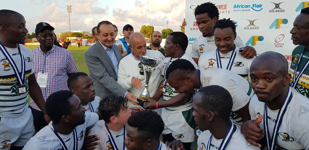 Zimbabwe are handed the trophy for winning the Rugby Sevens 2018 Africa Championship ©Rugby Afrique