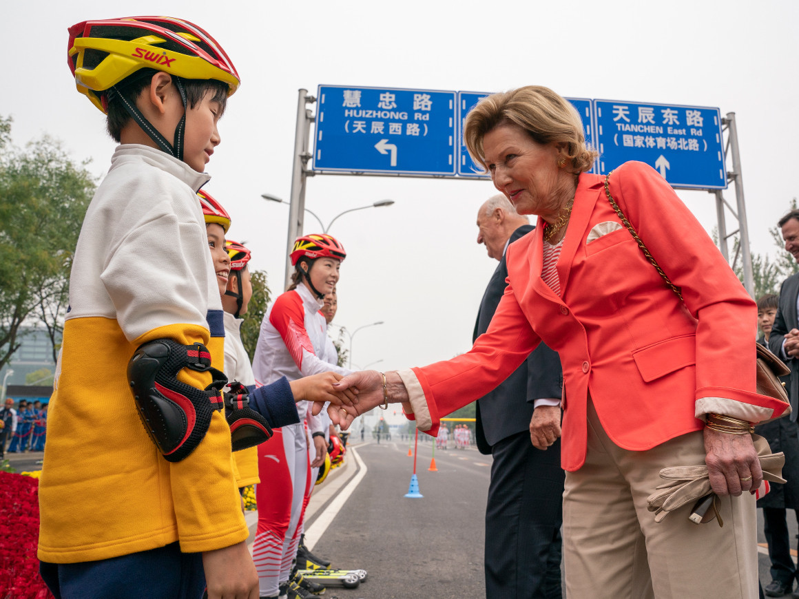 Norway's Queen Sonja shakes hands with young competitors after the special roller skiing event held in Beijing ©The Royal House of Norway
