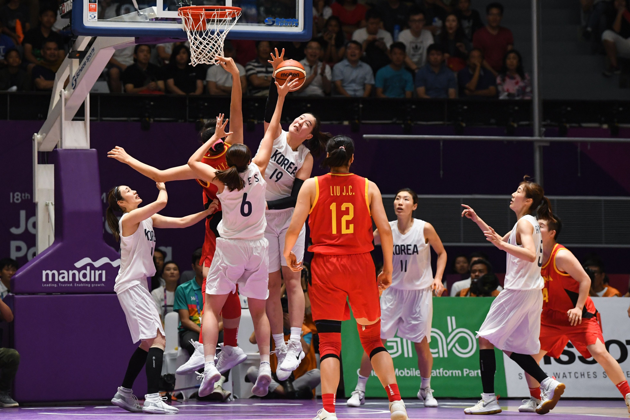The two Koreas formed joint teams in three sports at this year's Asian Games including 5x5 basketball ©Getty Images