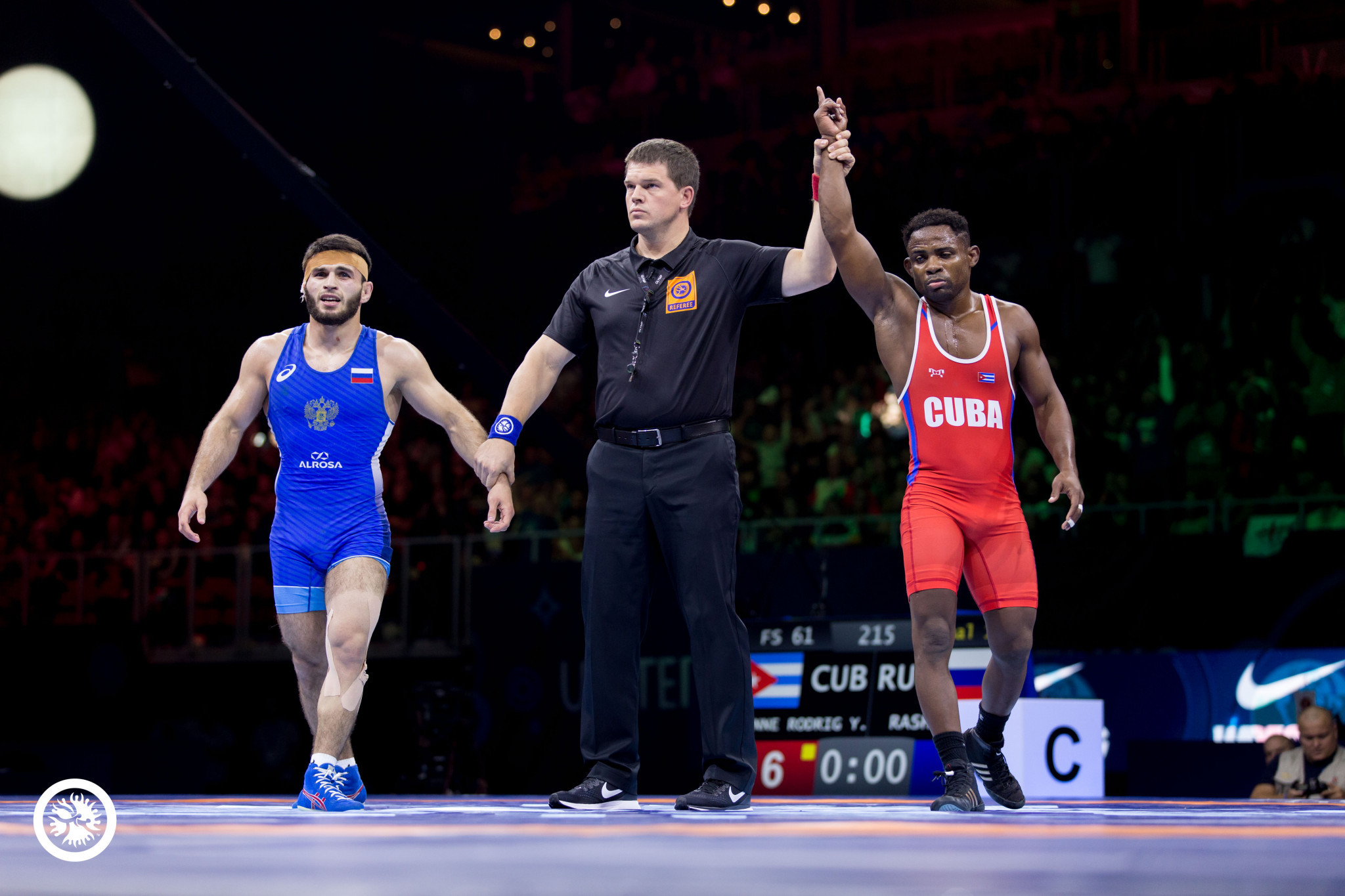 Cuba's Yowlys Bonne Rodriguez won the first gold of the 2018 World Wrestling Championships amid choatic scenes as his opponent's coach was shown a red card for abusing the referee ©UWW