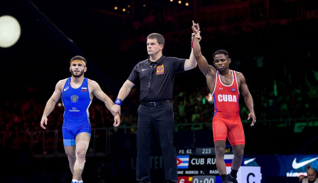 Yowlys Bonne Rodriguez from Cuba, right, won the first gold of the World Championships today as his Russian opponent's coach was shown a red card for abusing the referee ©UWW