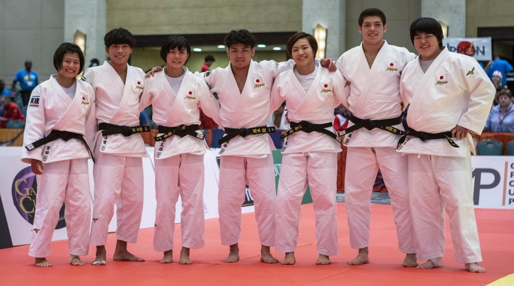 Japan celebrate a dominant final performance for the gold medal ©IJF