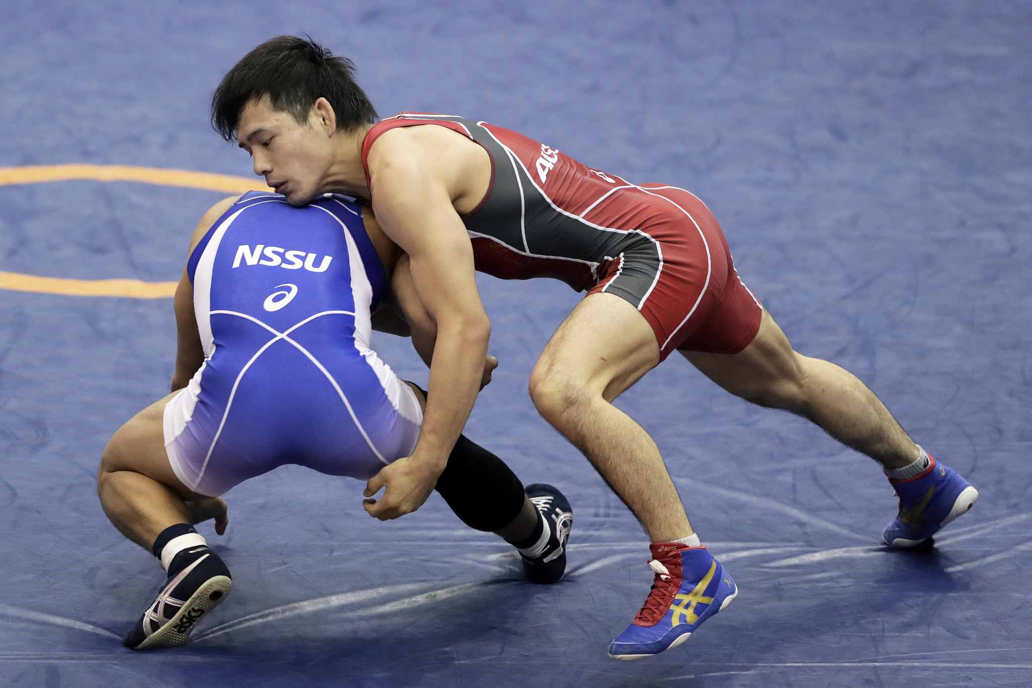Yuki Takahashi, red, became Japan's youngest ever wrestling World Champion at 19-years-old ©Getty Images