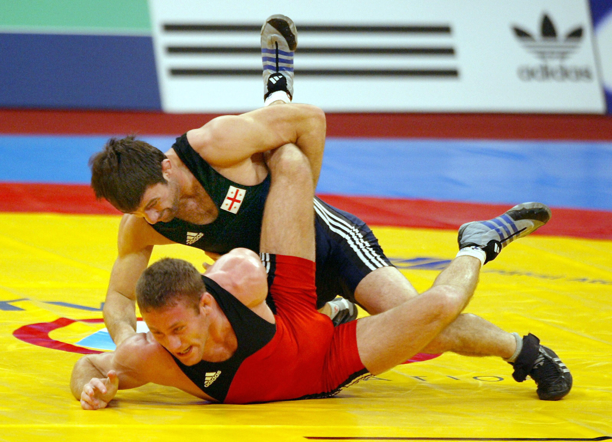 Gergő Wöller, in red, was one of five Hungarian wrestlers honoured with special awards at the Wrestling World Championships today to mark Republic Day ©Getty Images