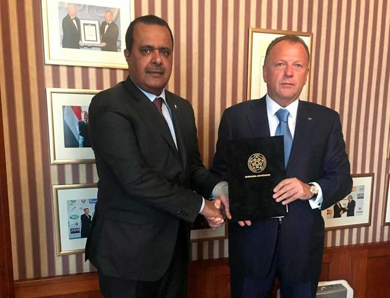 IJF President Marius Vizer, right, and the President of the Qatar Taekwondo, Judo and Karate Federation, Khalid Hamad Al Atiya, pictured after their joint signing at the IJF HQ in Budapest ©IJF