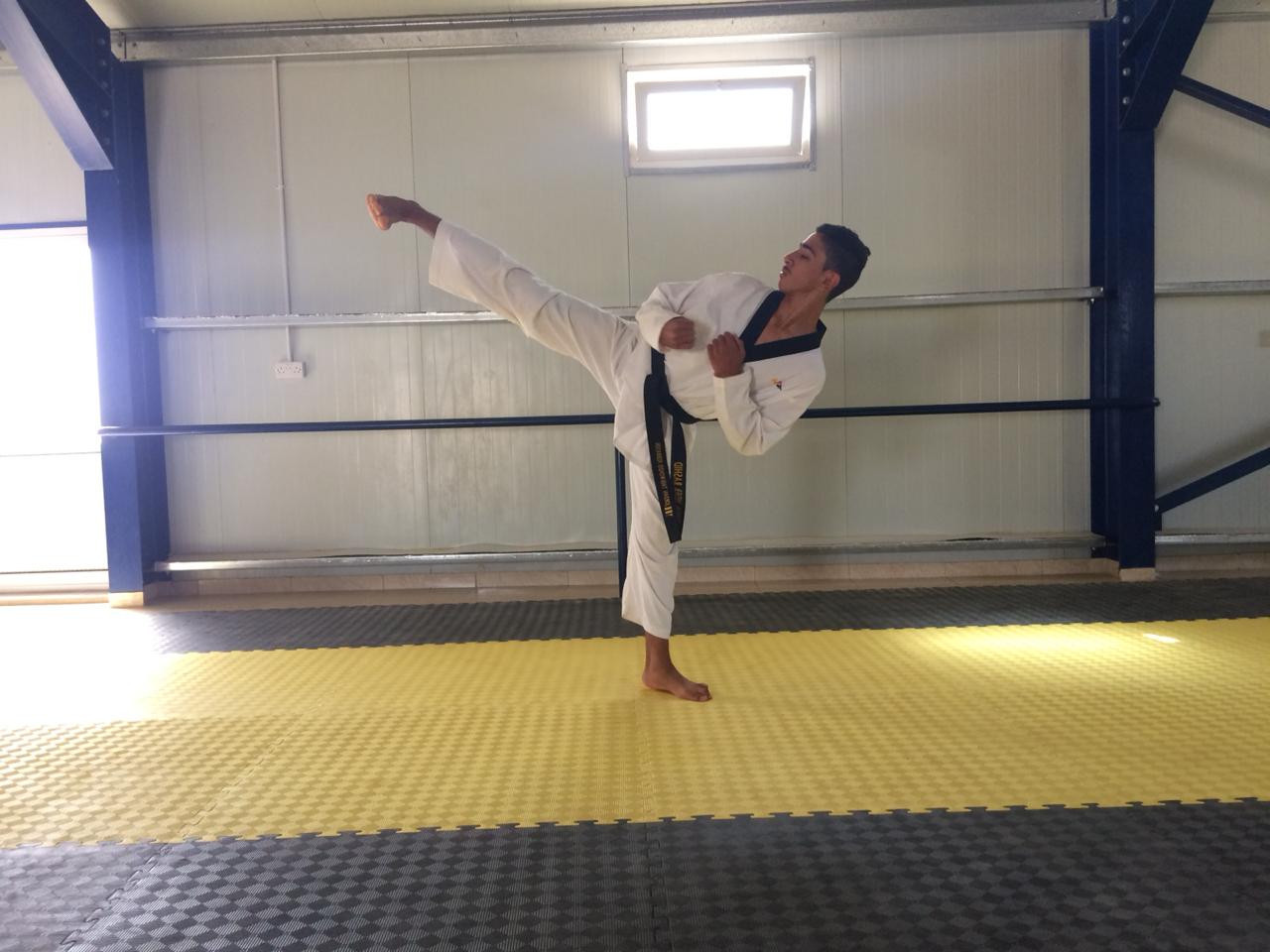 Second refugee achieves black belt at Taekwondo Humanitarian Foundation Academy