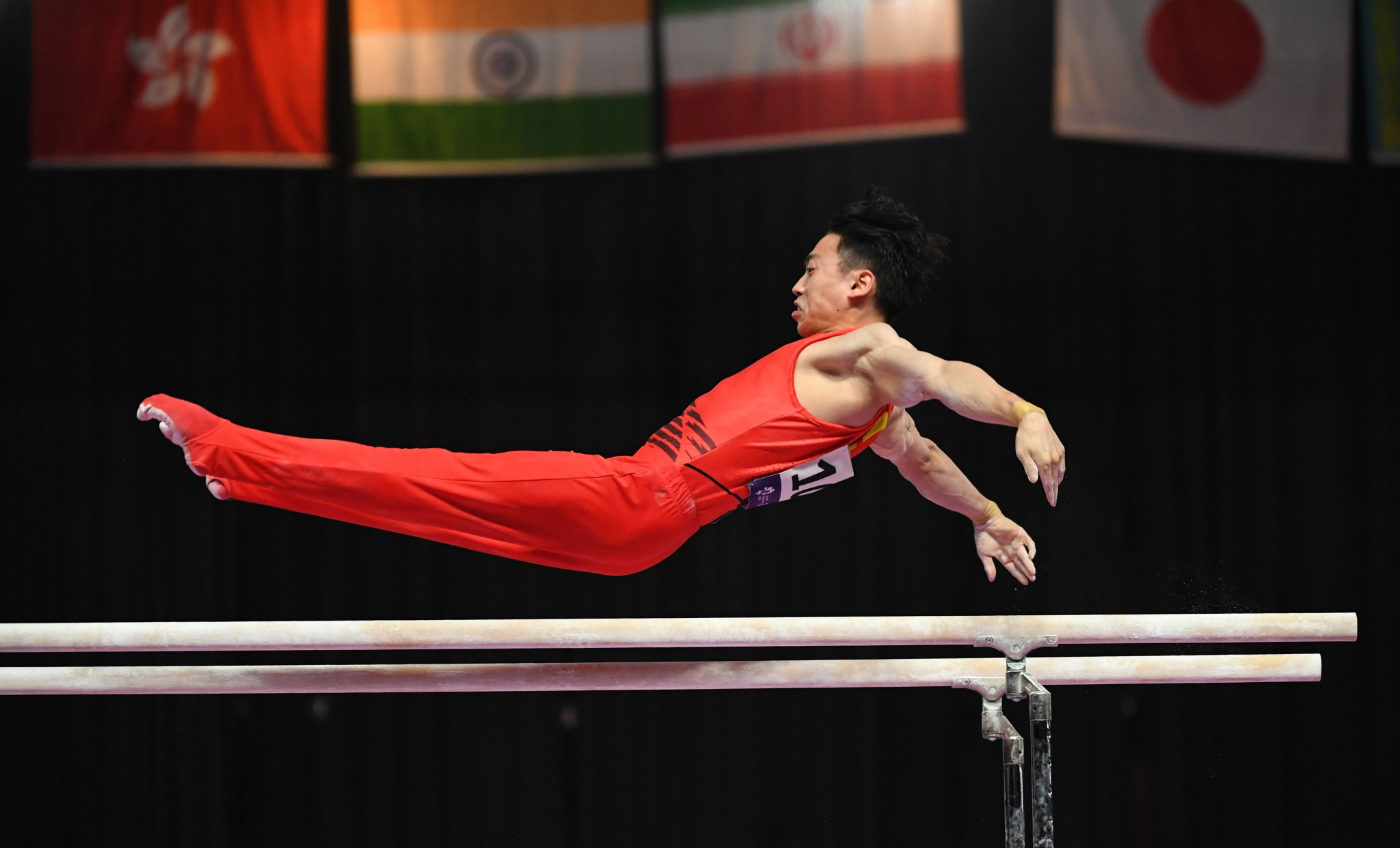 Zou Jingyuan of China produced a near-perfect routine to claim parallel bars gold ©Getty Images