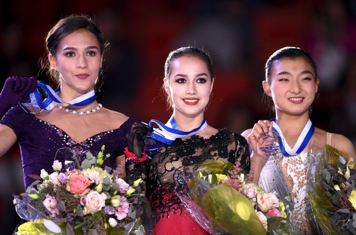 Silver medalist Stanislava Konstantinova, left,  and gold medalist Alina Zagitova, both of Russia, and bronze medalist Kaori Sakamoto of Japan pose on the podium after the women's competition ©Getty Images