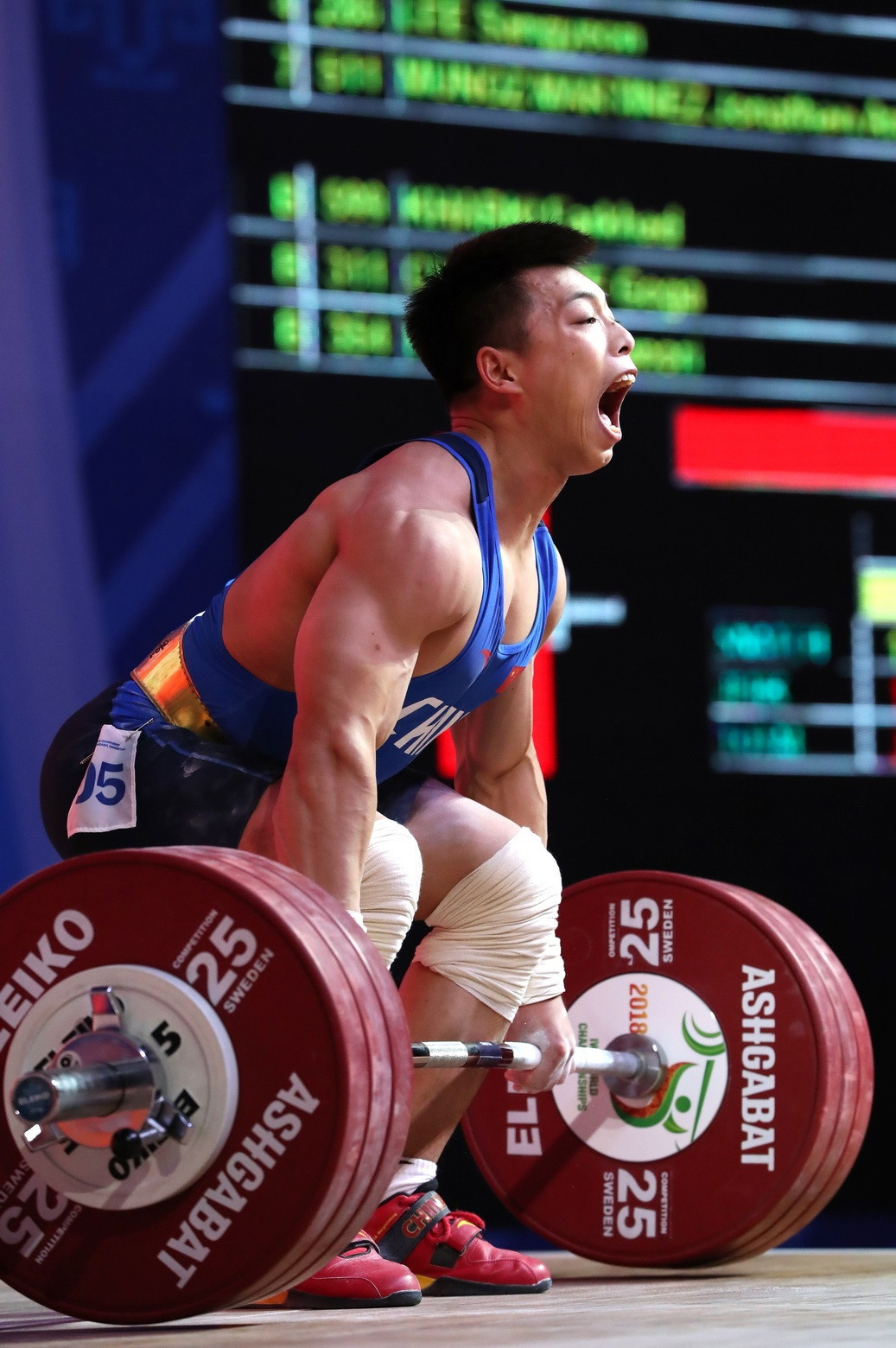 China's Chen Lijun broke the world standard total to top the men's 67kg podium ©IWF