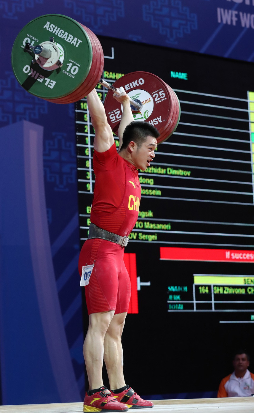 China's Shi Zhiyong set world standards in the snatch, clean and jerk and total as he cruised to victory in the men's 73 kilograms category at the 2018 International Weightlifting Federation World Championships in Turkmenistan's capital ©IWF