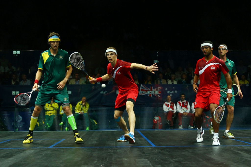England and Australia contest the men's doubles at the Glasgow 2014 Commonwealth Games. The sport is now questioning how an Olympic version remains as far away as ever ©Getty Images