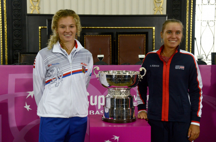 Czech Republic's Katerina Siniakova, left, and Sofia Kenin of the United States pose with the trophy after a draw ceremony for the  Fed Cup that starts in Prague tomorrow ©Getty Images