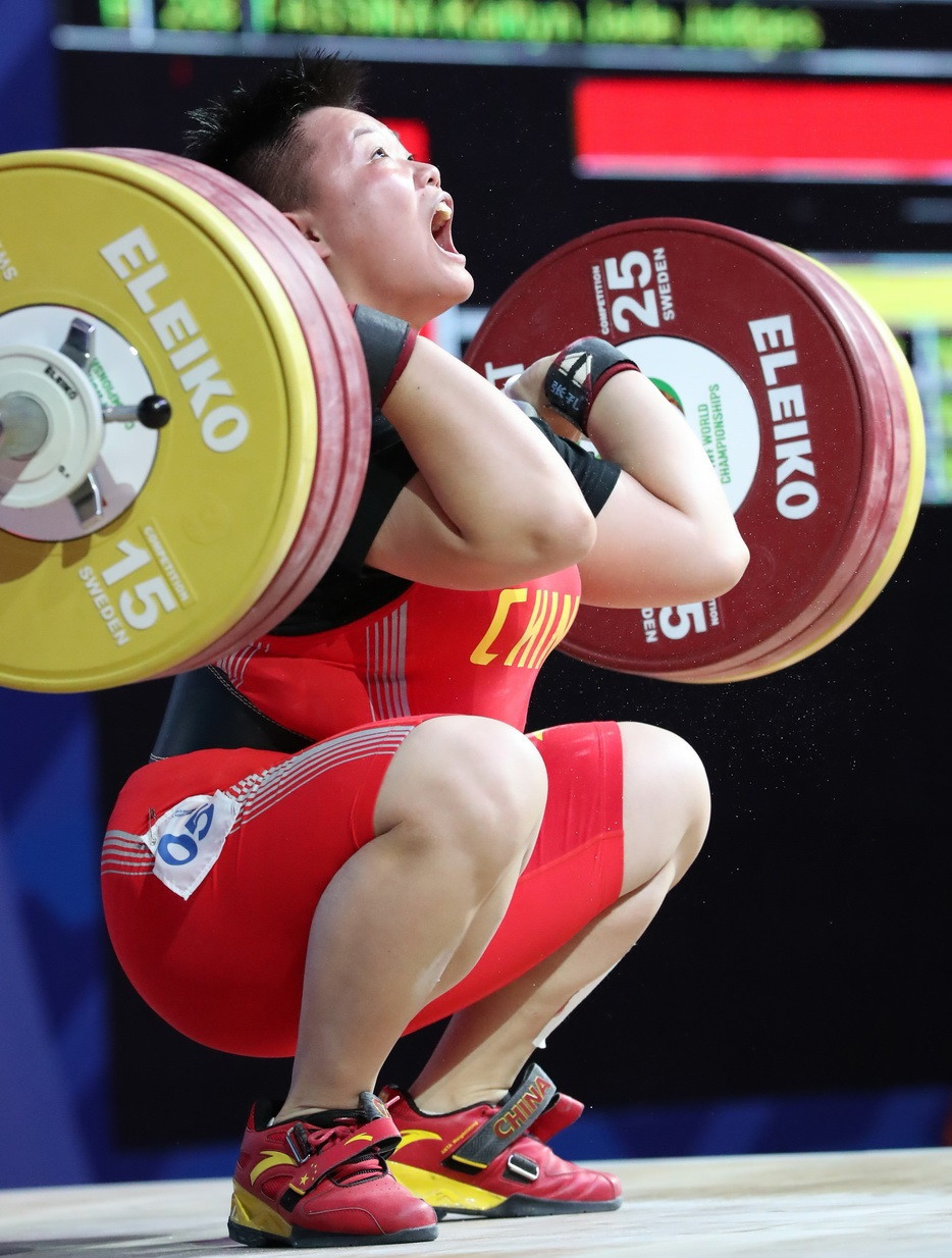 China's Ao Hui beat North Korea's Kim Un Ju to the women's 87kg overall gold medal following an intriguing battle between the two lifters ©IWF