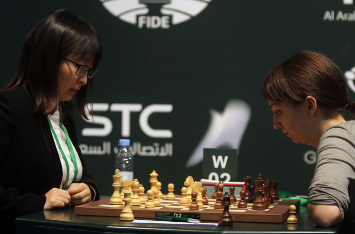 Defending champion Ju Wenjun of China, left, is through to the semi-finals of the Women's World Chess Championships after beating Uzbekistan's Guirukhbegim Tokhirjonova in Russia ©Getty Images
