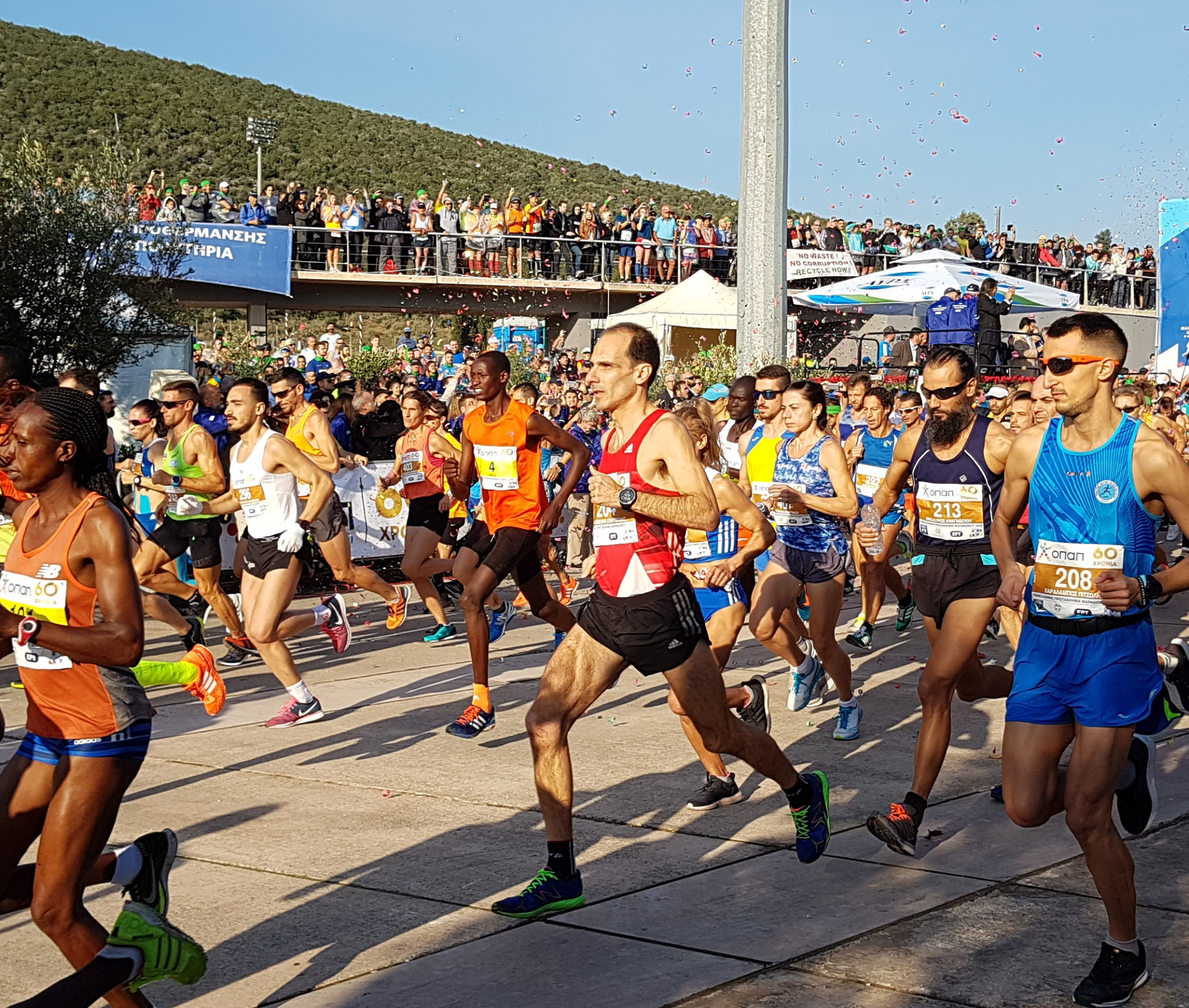 Runners depart Marathon en route for Athens in Sunday's race ©ITG