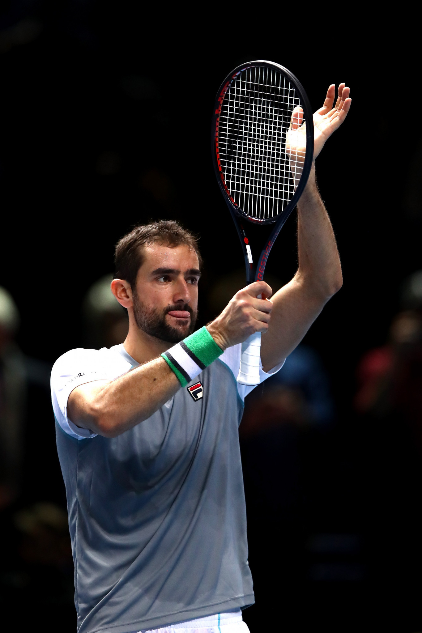 Cilic victory over Isner puts Djokovic through to semi-finals at ATP Finals in London