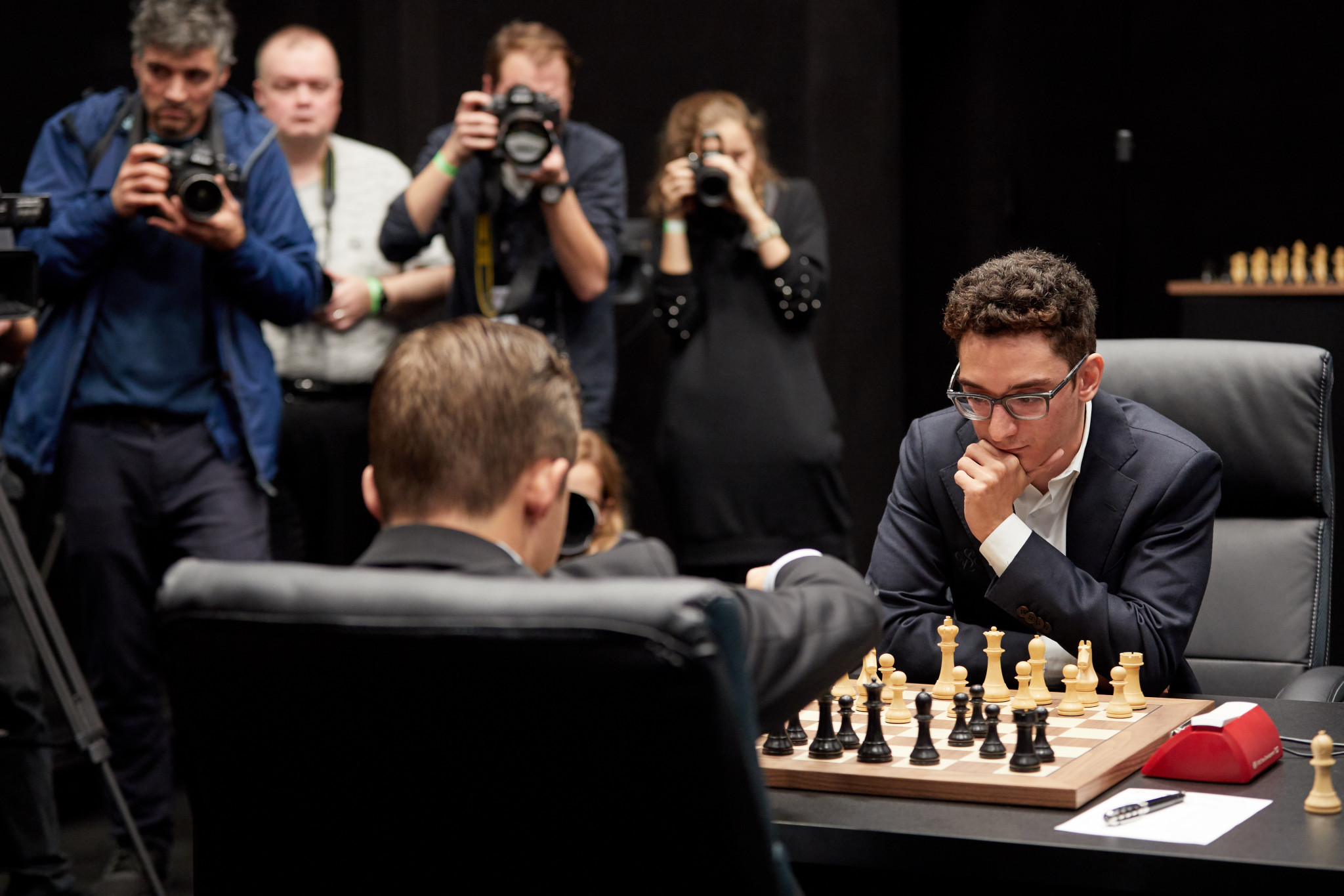 Defending champion Magnus Carlsen, left, and challenger Fabiano Caruana have played out a fifth successive draw in their World Chess Championship at Holborn in central London ©Getty Images