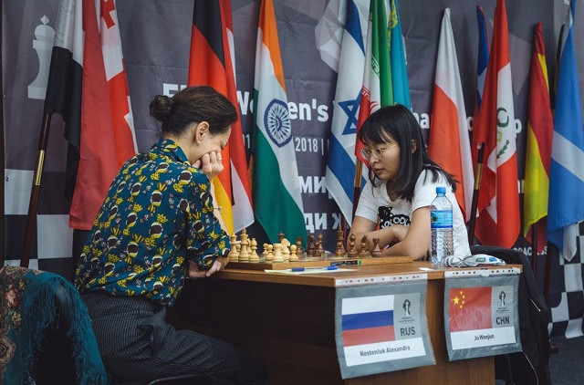 China's defending champion Ju Wenjun went 1-0 up today in her Women's World Chess Championship semi-final against Russia's Alexandra Kosteniuk despite playing black ©FIDE