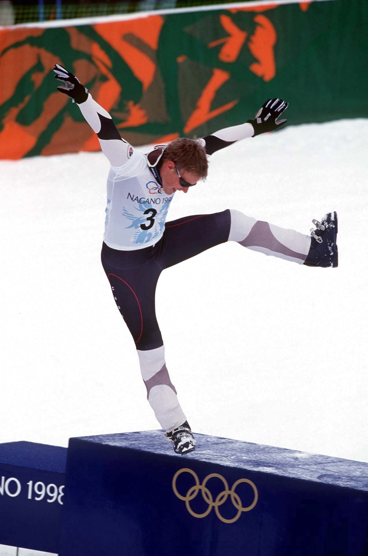 Canada's Ross Rebagliati arrives on the winners podium at the 1998 Nagano Winter Games as the first Olympic snowboard champion - a title he then lost, and regained after an issue with a positive sample for marijuana ©Getty Images
