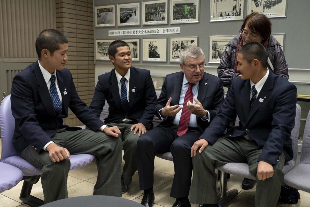IOC President Thomas Bach met three young baseball players during a visit to Fukushima ©IOC