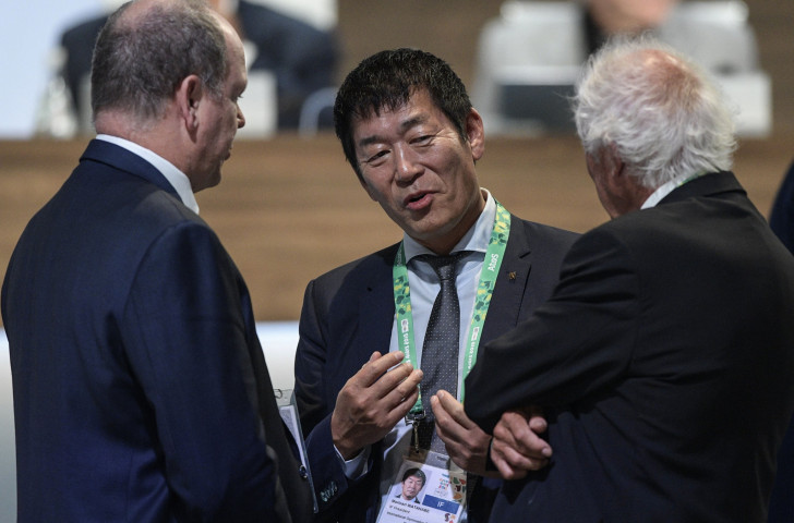 International Olympic Committee member Prince Albert of Monaco, left, recently elected member Morinari Watanabe and the general secretary of the International Gymnastics Federation Andre Gueisbuhler chat during a break of the 133th IOC Session in Buenos Aires on October 8 this year ©Getty Images