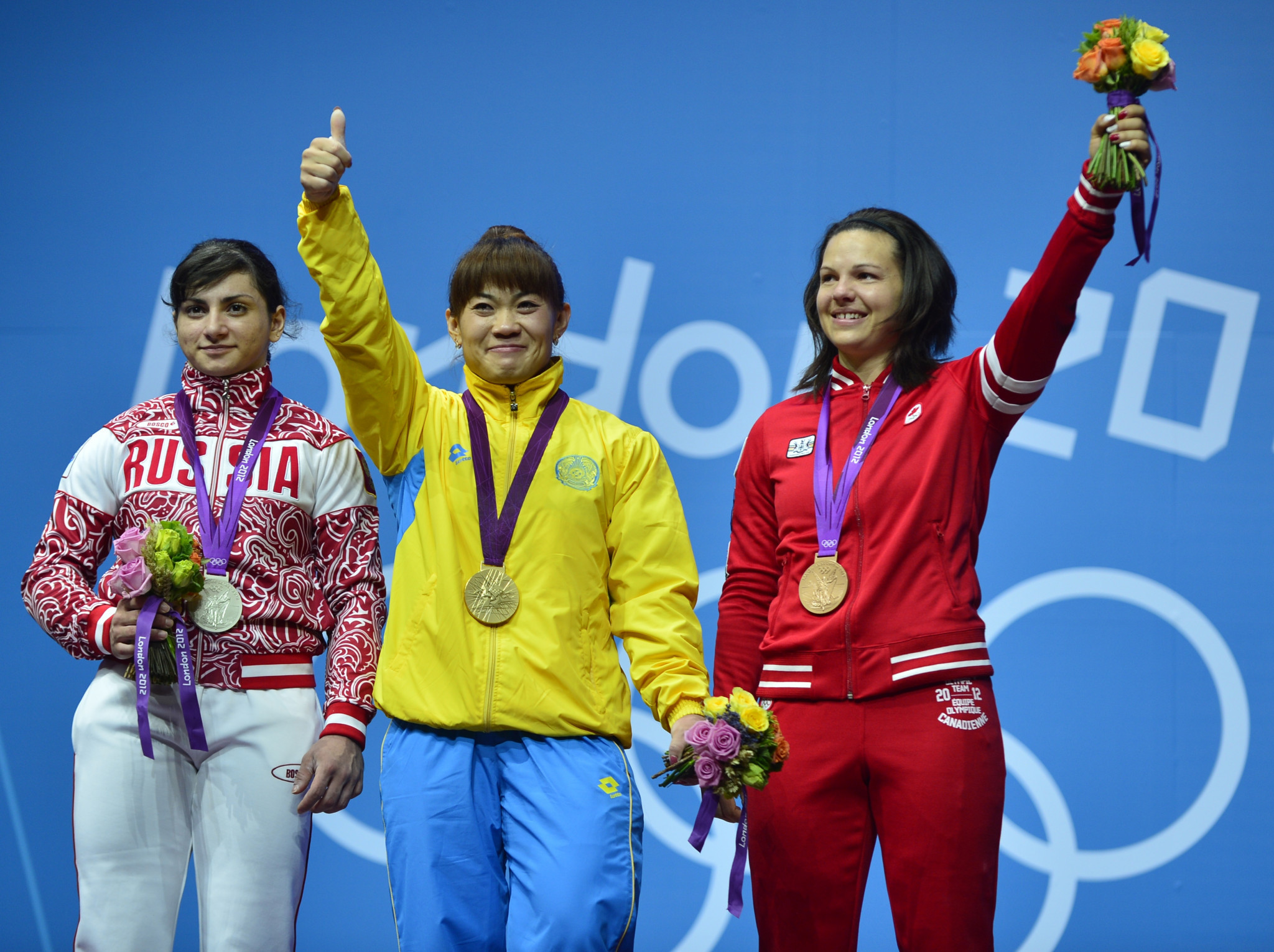 Christine Girard, right, originally finished behind Kazakhstan's Maiya Maneza, centre, and Russia's Svetlana Tsarukayeva, left, at London 2012, but they were both disqualified for doping ©Getty Images