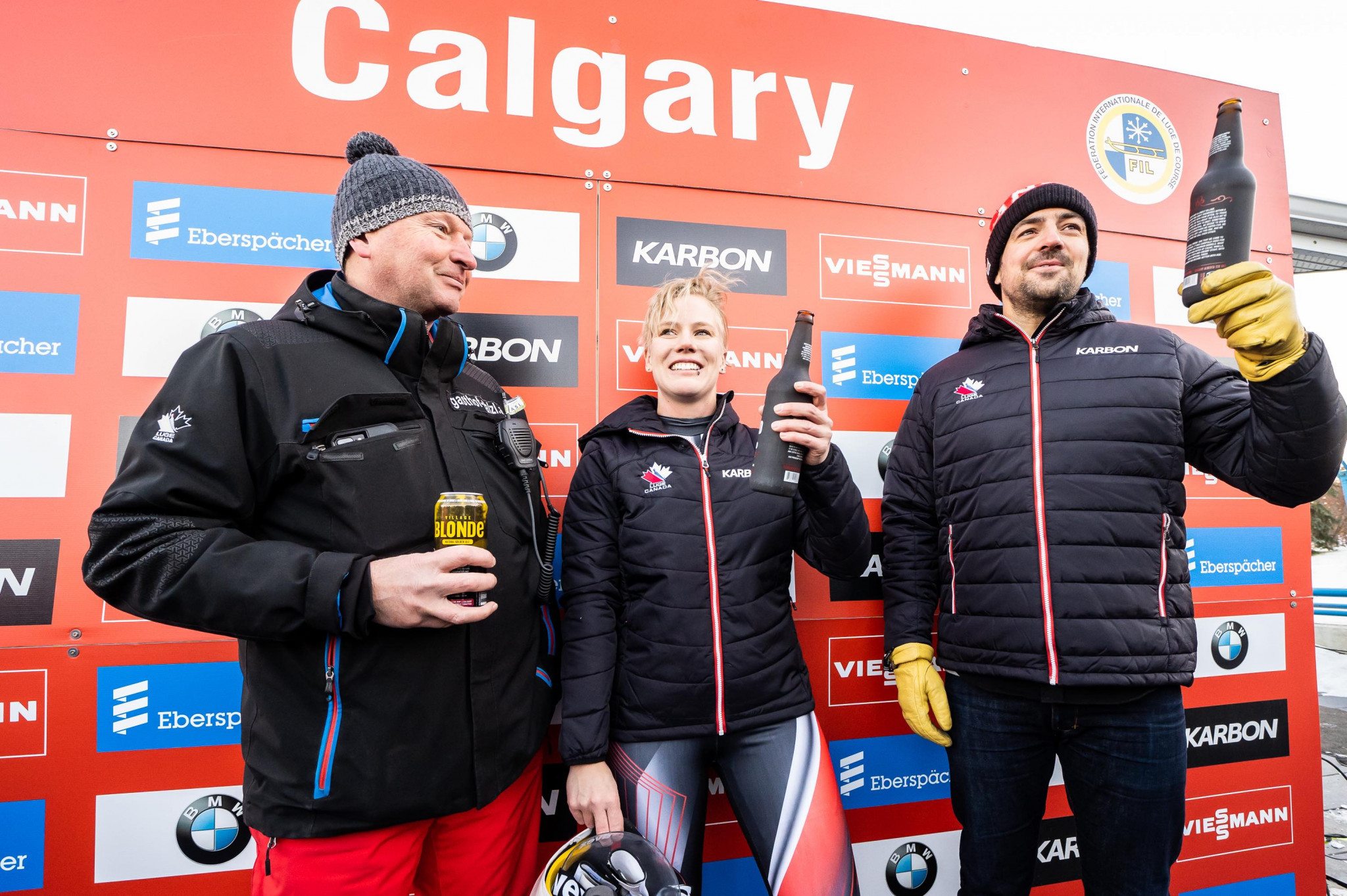 Canadian Olympic medalists Alex Gough and Sam Edney toasted their retirement with a Canadian brew at the Luge World Cup event in Calgary ©Canadian Luge Association