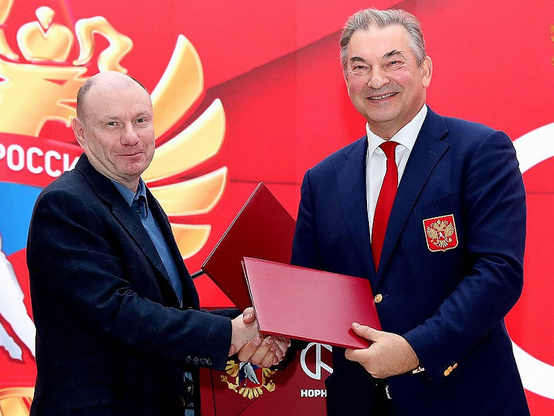 Vladimir Potanin, chairman of the Board of Norilsk Nickel. pictured, left, with Vladislav Tretiak, President of the Russian Ice Hockey Federation, at the announcement of a four-year sponsorship deal leading up to Beijing 2022 ©RHF