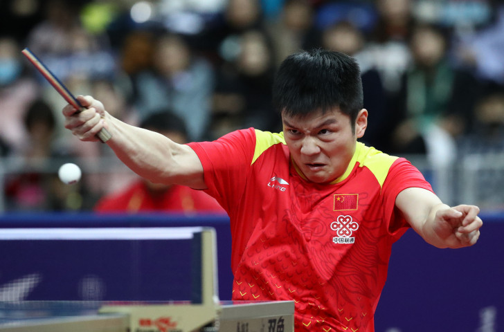China's defending champion Fan Zhendong en route to victory in his opening men's singles match at the ITTF World Tour Grand Finals in Incheon ©Getty Images