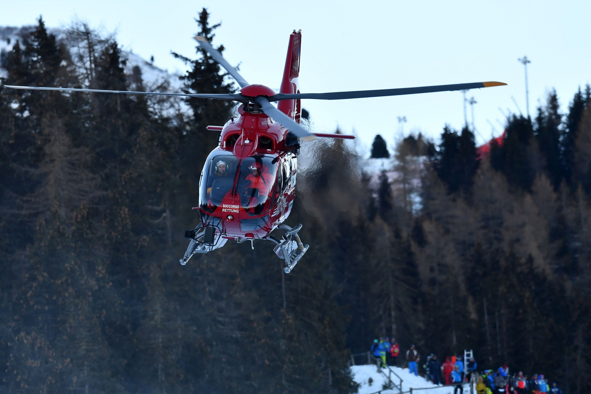 A helicopter airlifts Marc Gisin from the course after his serious crash ©Getty Images