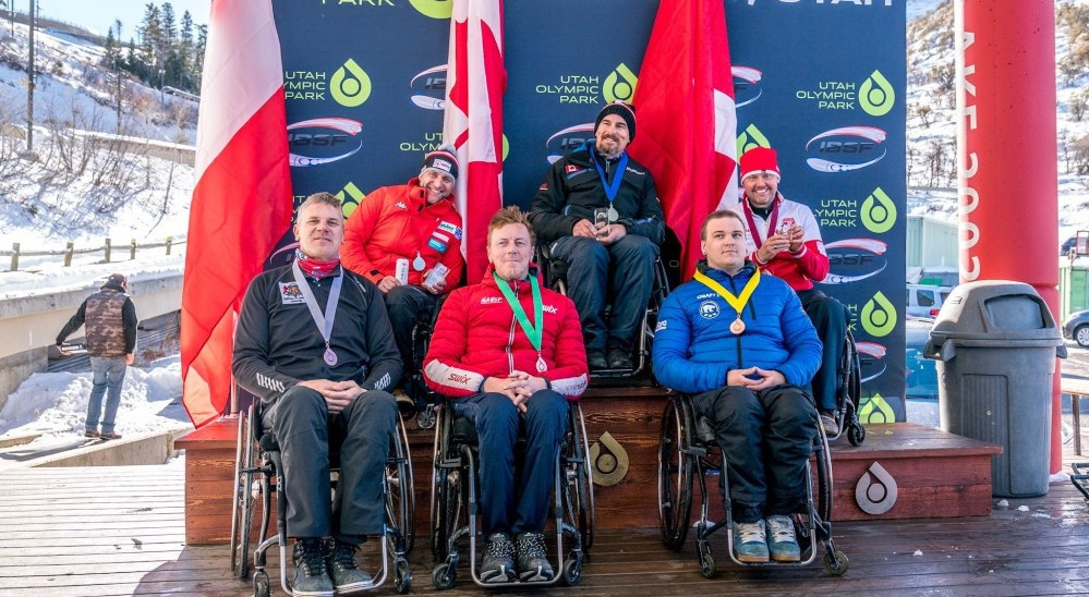 Canada's Lonnie Bissonnette, centre, celebrated a win double at the IBSF Para Bobsleigh World Cup in Park City ©IBSF