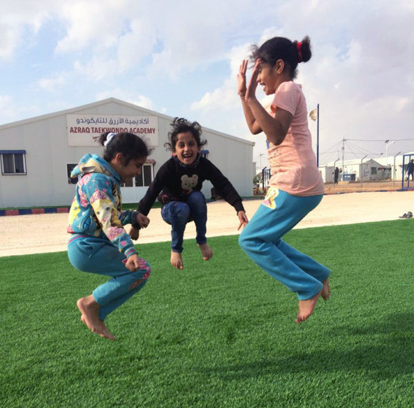 The artificial turf newly installed at the Academy in Jordan's Azraq camp is proving a hit already ©THF