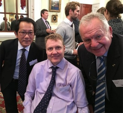 IWRF President Richard Allcroft, centre, in London with Takahiro Waku of the Japan Sports Council, left, and Bill Beaumont, chairman of World Rugby ©IWRF